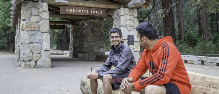 Visitors at the Yosemite Falls shuttle stop. Photo: Yosemite Conservancy/Keith Walklet.