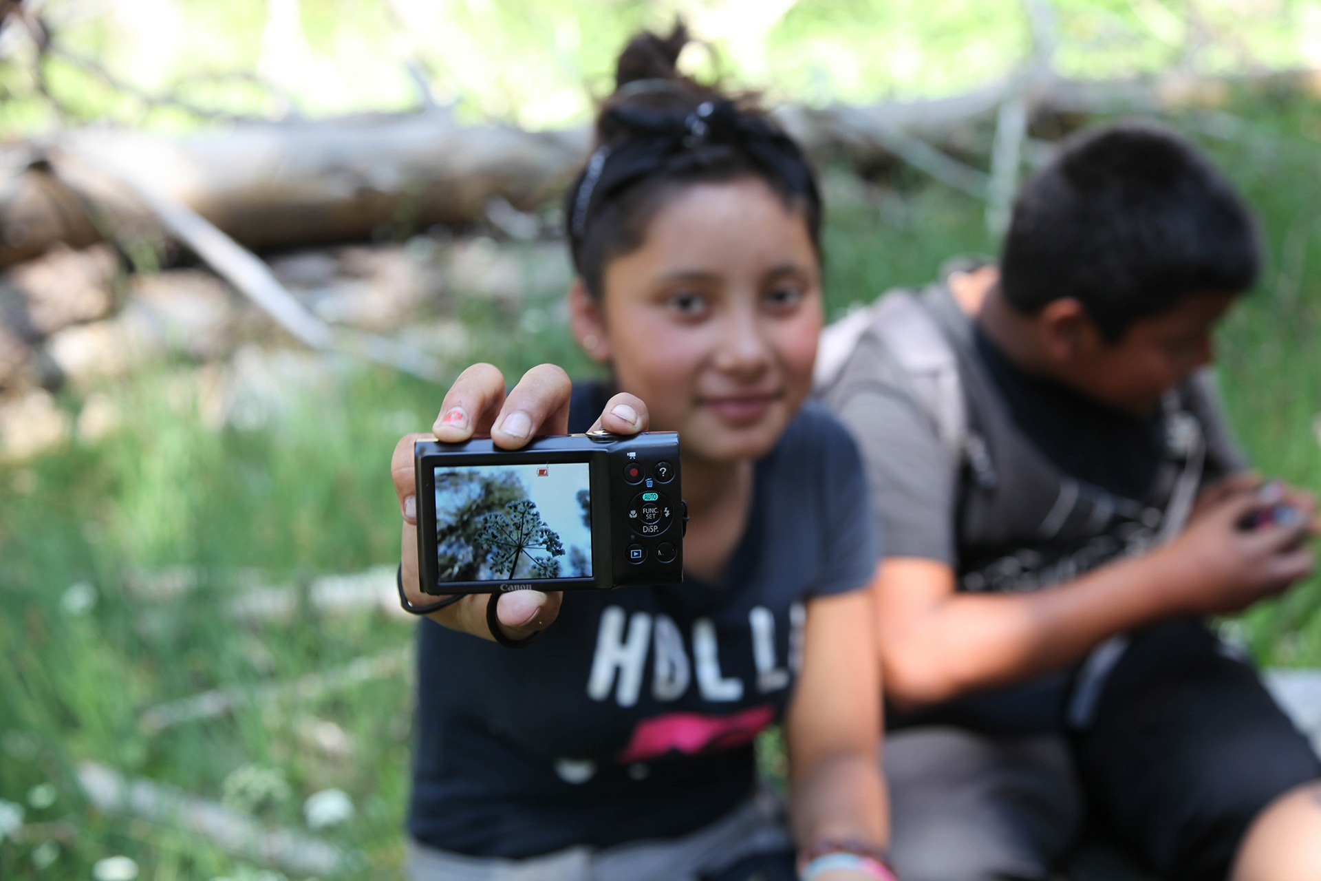 A Parks in Focus student shows off a photo she captured during a Yosemite trip.