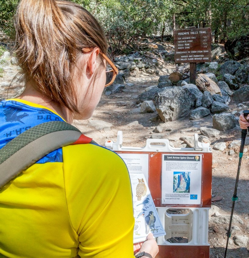 Temporary signs near climbing areas alert hikers and climbers when routes are closed to protect peregrine nesting sites. Photo: Yosemite Conservancy/Keith Walklet.