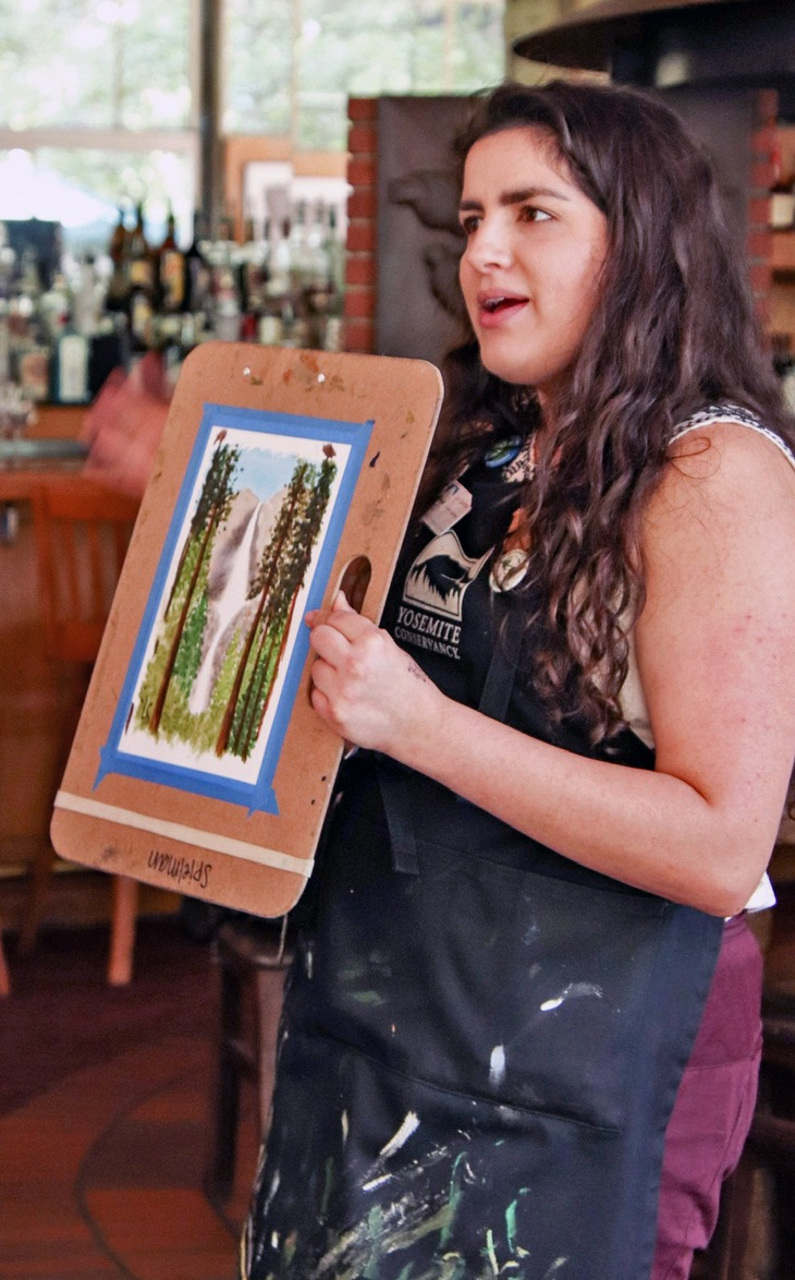 """Wine and Paint"" program at Yosemite Valley Lodge, in June 2019. Pictured: The Conservancy's Lora Spielman leading the painting class. Photo: Cindi Wood."
