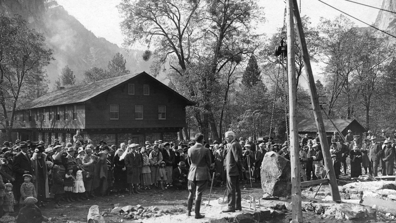 Black and white photo of a crowd gathered for a cornerstone ceremony for the Yosemite Museum on November 16, 1924. Stephen Mather, the first director of the National Park Service, presides over the ceremony. Photo courtesy of the Yosemite Research Library (RL-13611).