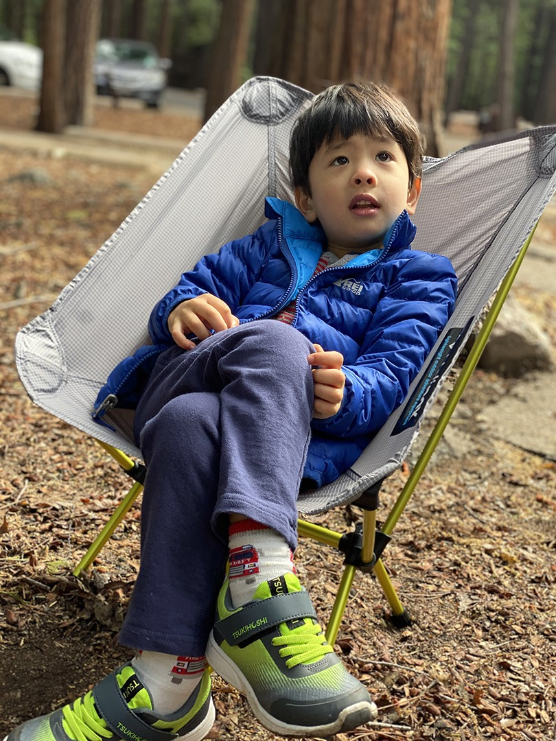 Owen, age 4, relaxes in a camp chair at Upper Pines Campground in Yosemite Valley.