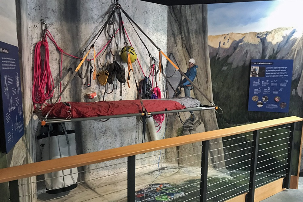 One of the displays featured in the new Climbing and Stewardship Exhibit at the Valley Visitor Center shows some of the gear a climber might need for a multiday ascent, including ropes, shoes, a helmet and a portaledge. Photo: Yosemite Conservancy/Ryan Kelly.